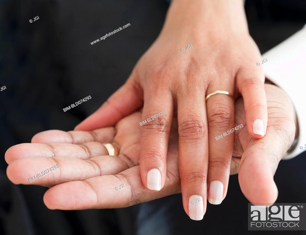 Stock Photo: Close up of African couple holding hands.