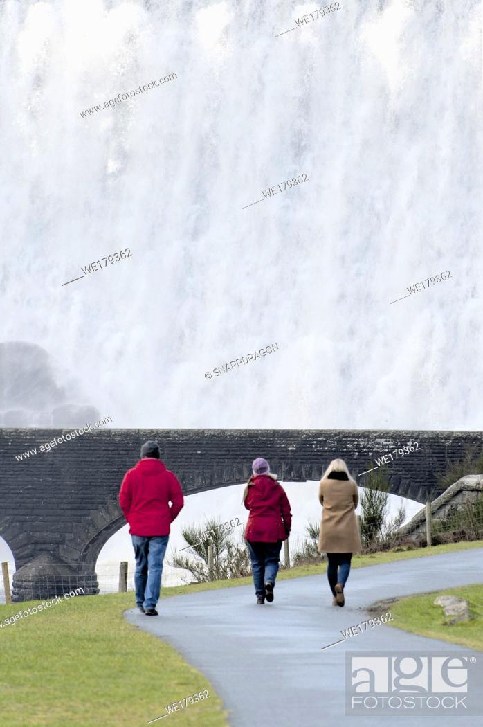 Stock Photo: Elan Valley, Powys, Wales, UK. Water cascades over the Caban-coch dam, at Elan Valley village near Rhayader in Powys, Wales, UK. .