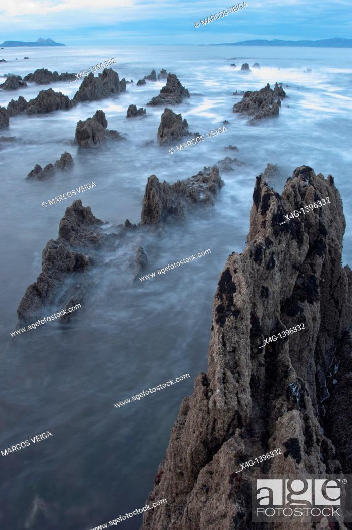 Stock Photo: Ria de Vigo coastline with Cies islands on the background  Nigran, Pontevedra, Galicia, Spain.
