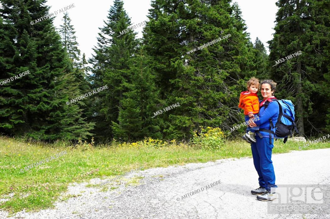 Stock Photo: A mother embrace her eighteen months old baby during an hike on dolomites  Trentino Alto Adige  Italy.
