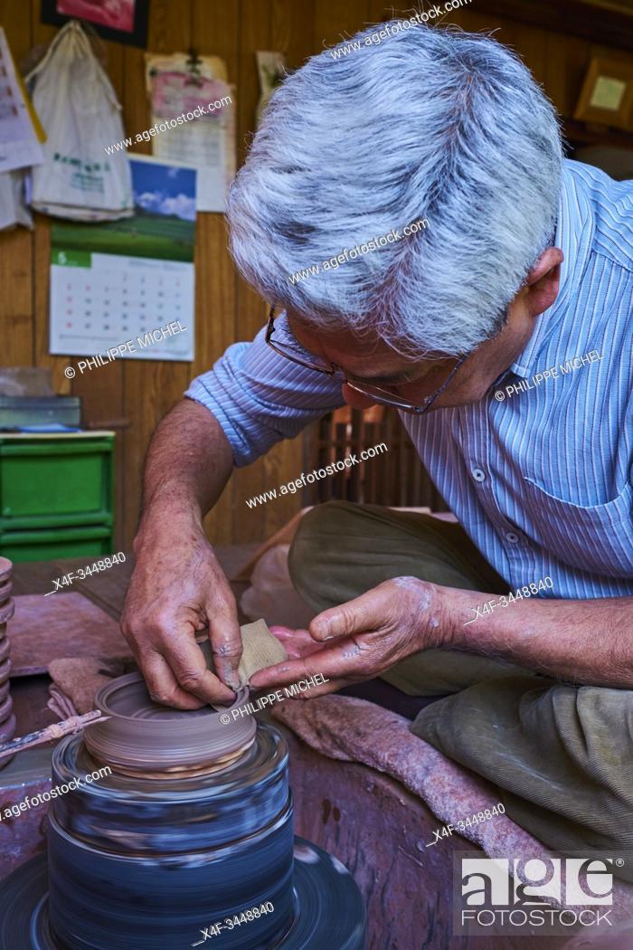 Stock Photo: Japan, Honshu, Aichi prefecture, Tokoname, Mr Seize Itou potter making a Kyusu teapot.