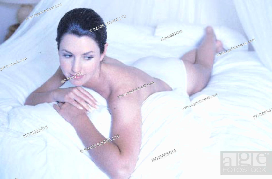 Stock Photo: Woman lying on bed.