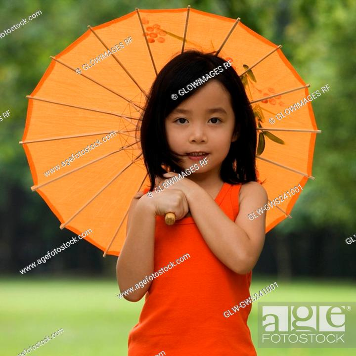 Stock Photo: Portrait of a girl holding a parasol.
