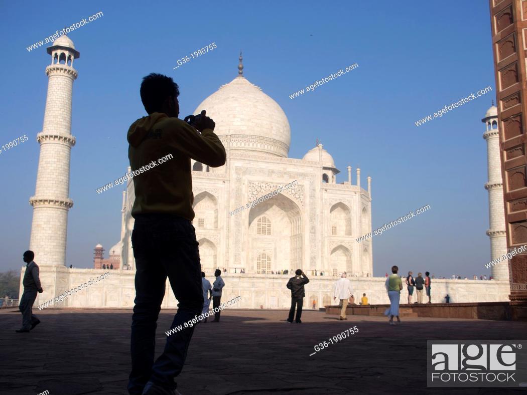 Stock Photo: Silhouette of tourists at Taj Mahal in Agra, Uttar Pradesh, India.