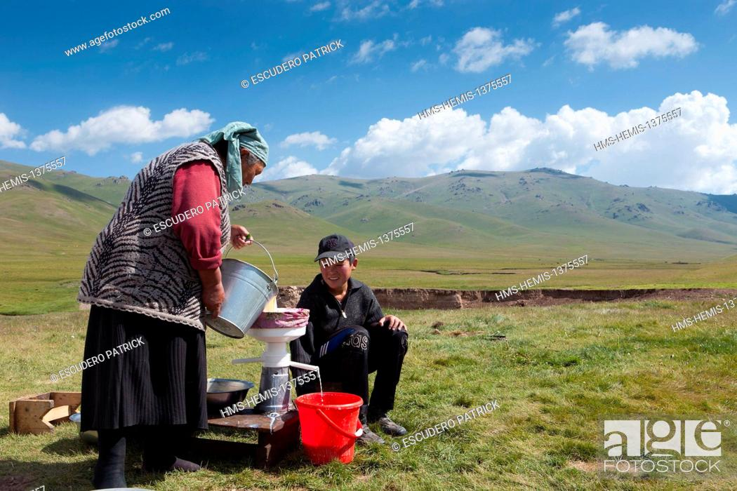 Stock Photo: Kyrgyzstan, Naryn Province, women making butter on mountain pastures at Song-Kol lake state zoological reserve.