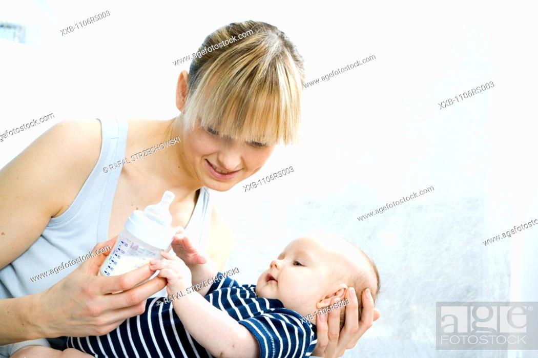 Stock Photo: mum feeding baby.