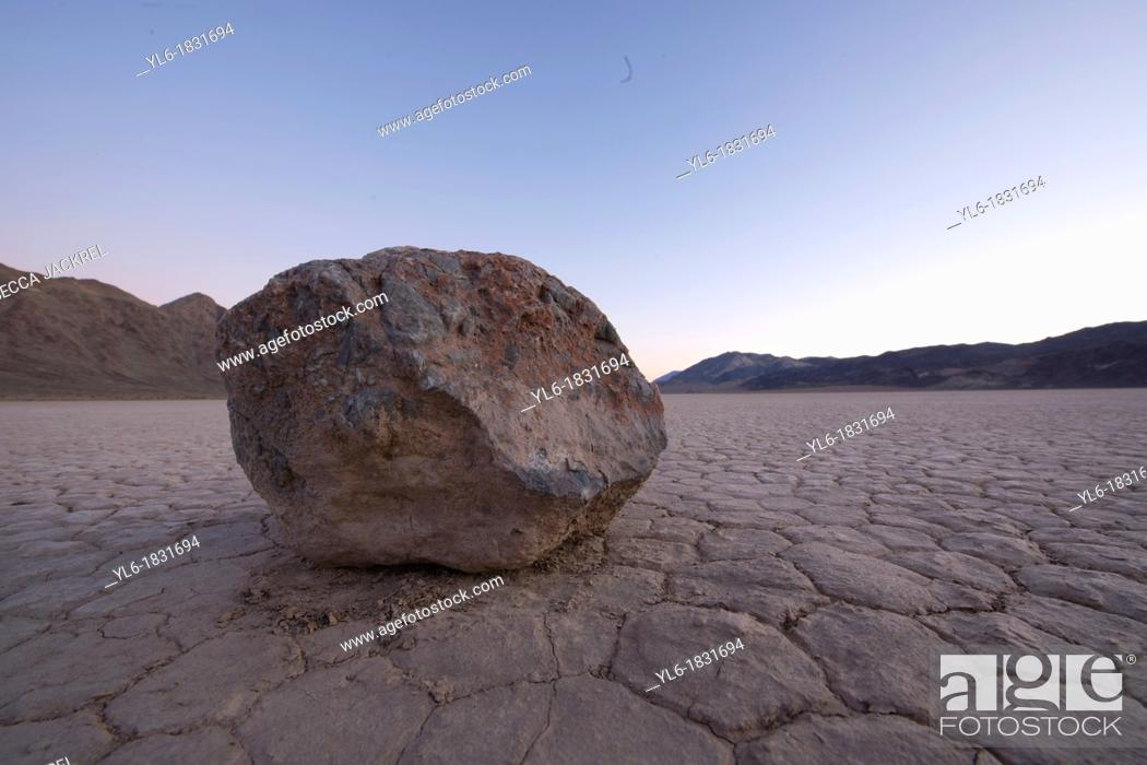 Stock Photo: A solitary rock sitting on a dry lake bed in Death Valley.