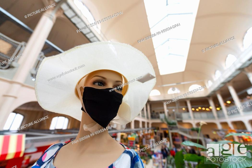 Stock Photo: 06 May 2020, Saxony, Dresden: A mannequin with a face mask is standing in the Neustadt market hall on the edge of a press conference on the security of supply.
