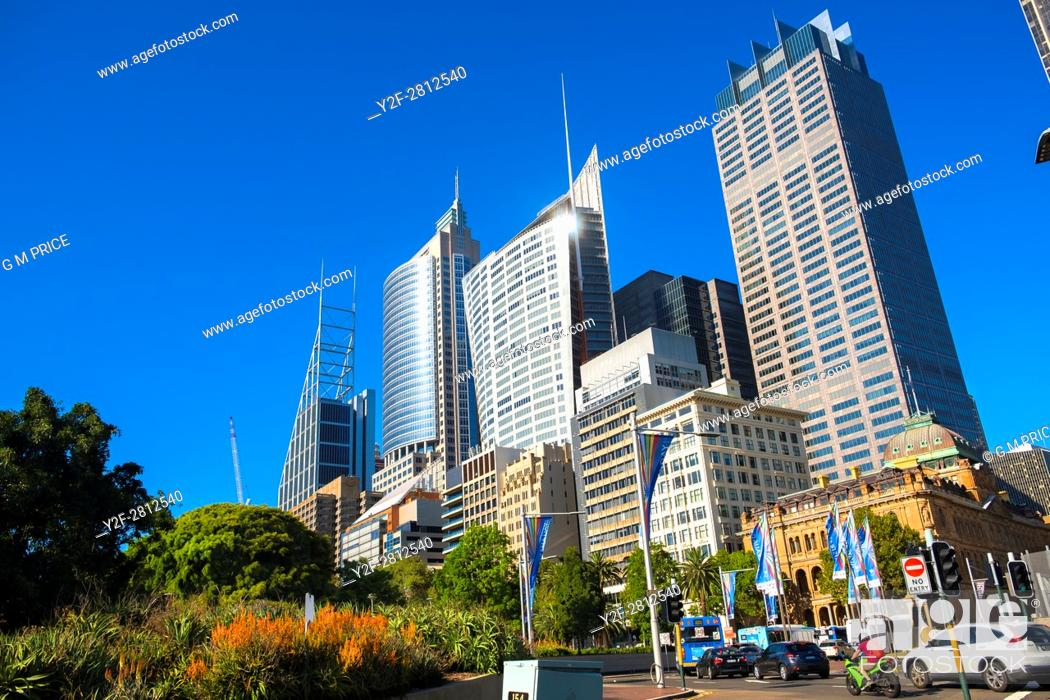 Stock Photo: morning traffic and high rise buildings along Macquarie Street, Sydney.