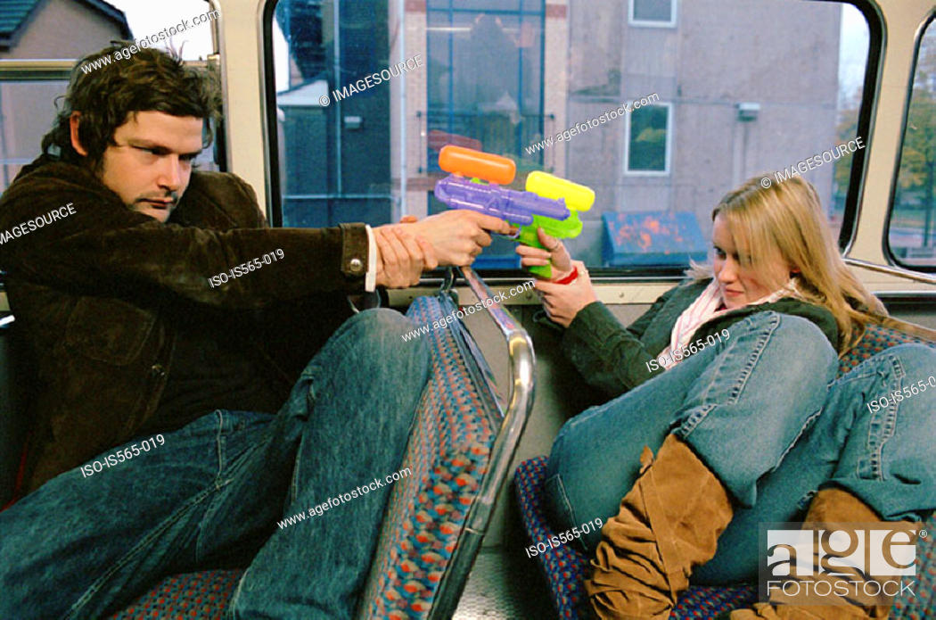 Stock Photo: Couple with water pistols.
