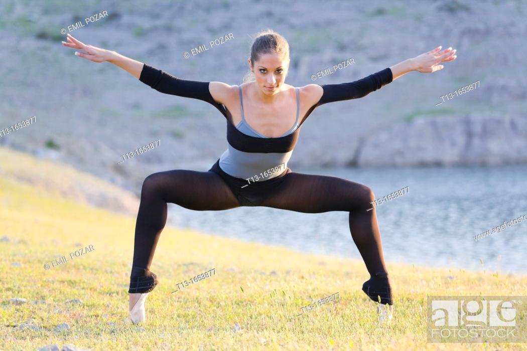 Stock Photo: Standing on her tiptoes, attractive ballerina.