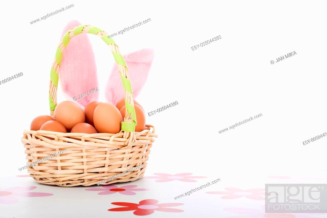 Stock Photo: Easter basket with eggs and bunny ears, Easter decoration background with copy space, isolated on white background.