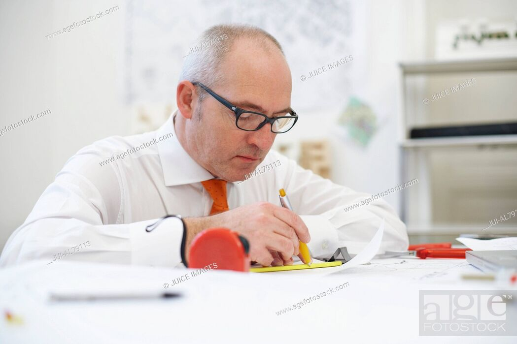 Stock Photo: Man concentrating on work.