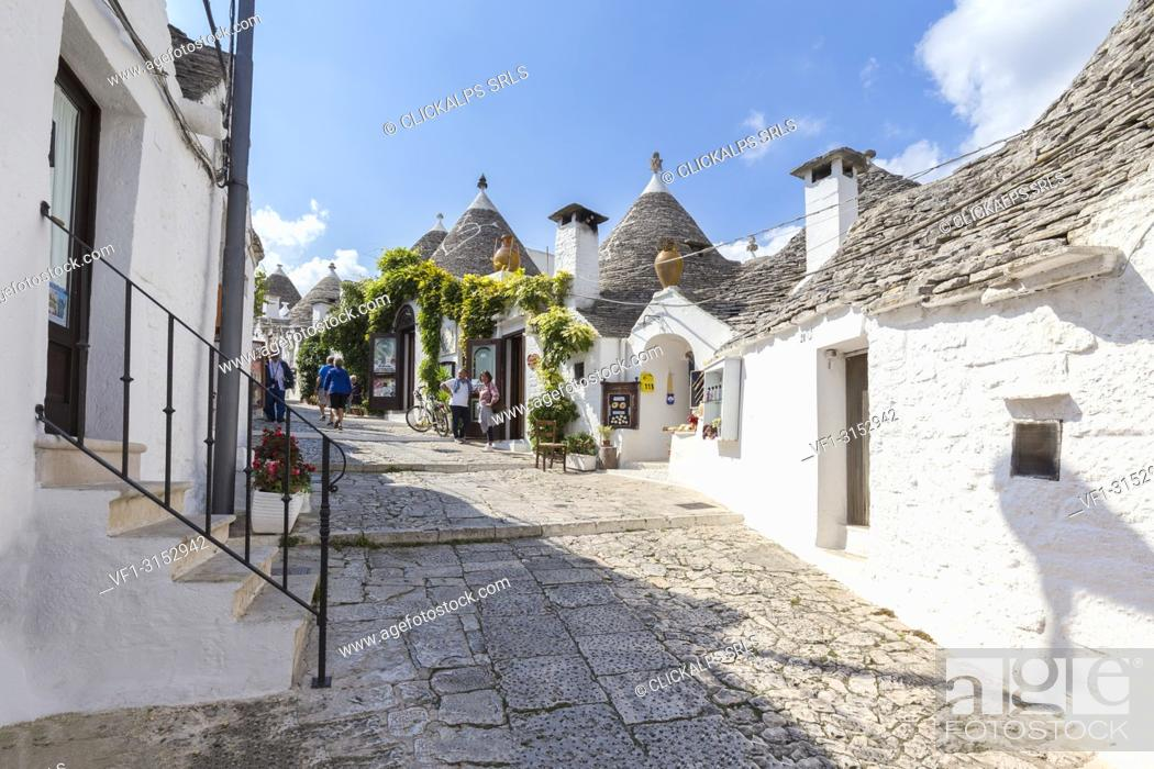 Stock Photo: View of the typical Trulli huts and the alleys of the old village of Alberobello. Province of Bari, Apulia, Italy, Europe.