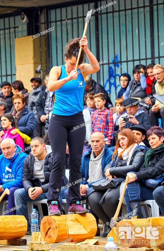 Stock Photo: Competition of female Aizkolaris, Cutting of logs, Plaza de la Trinidad, Feria de Santo Tomás, The feast of St. Thomas takes place on December 21.