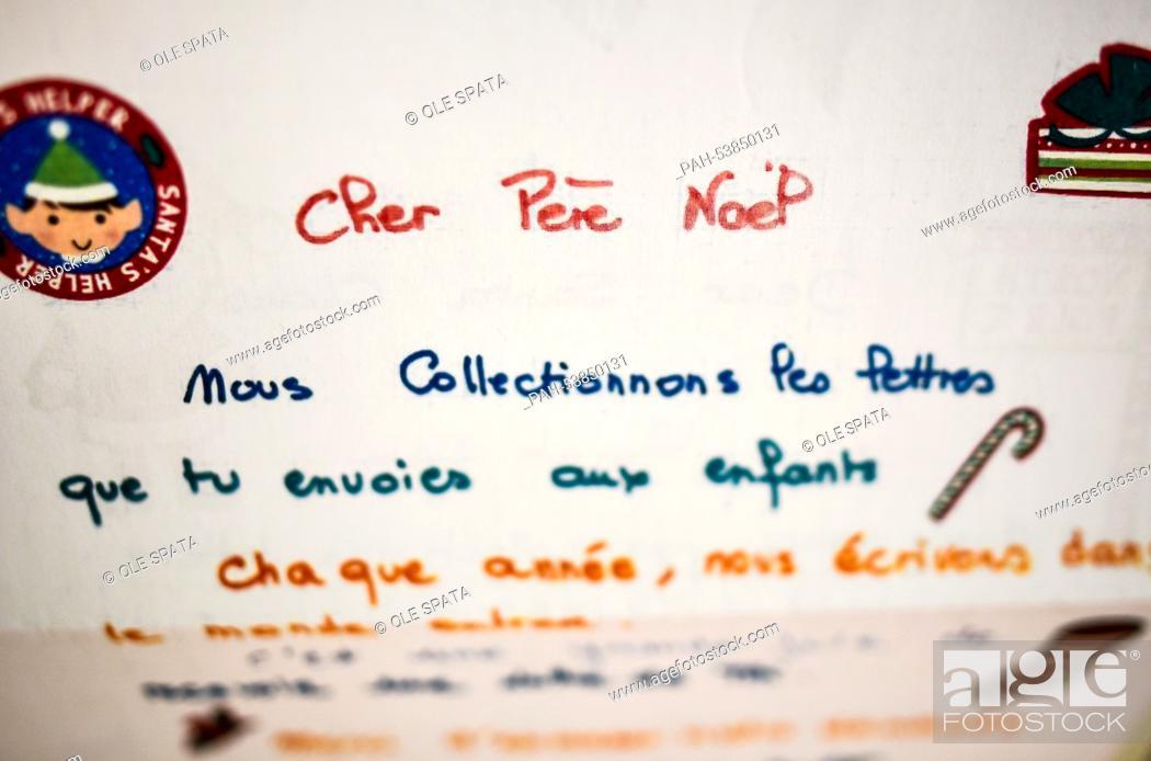 Dear Sant, in French Cher Pere Noe, is written on a letter