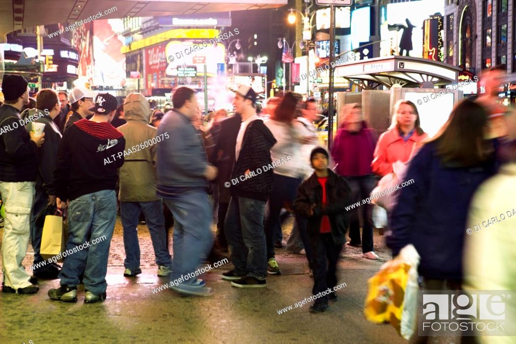 Stock Photo: Crowd scene on sidewalk near bus stop on Broadway in New York City looking north at Times Square.