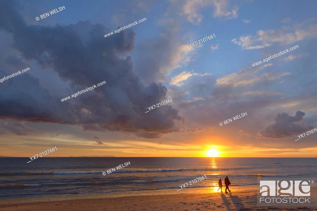 Stock Photo: Couple walking at sunset. Tarifa, Costa de la Luz, Cadiz, Andalusia, Spain.