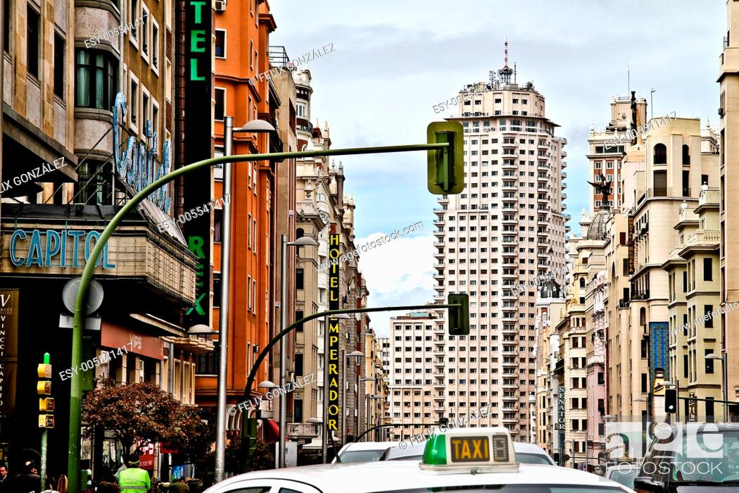 Stock Photo: Taxi at Gran Via street, Torre de Madrid in background, Madrid, Spain.