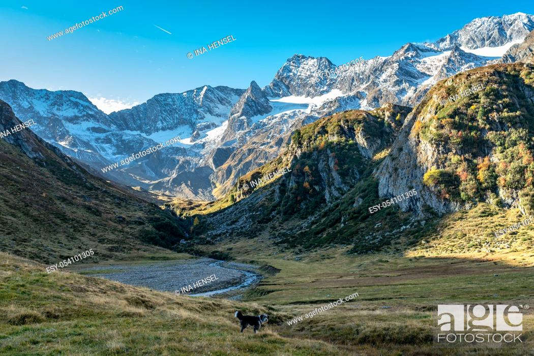 Stock Photo: Hiking path at Timmelsjoch and Texelgruppe nature park leading to the Seebersee lake with the alpine mountains in the background in a bright autumn day with a.