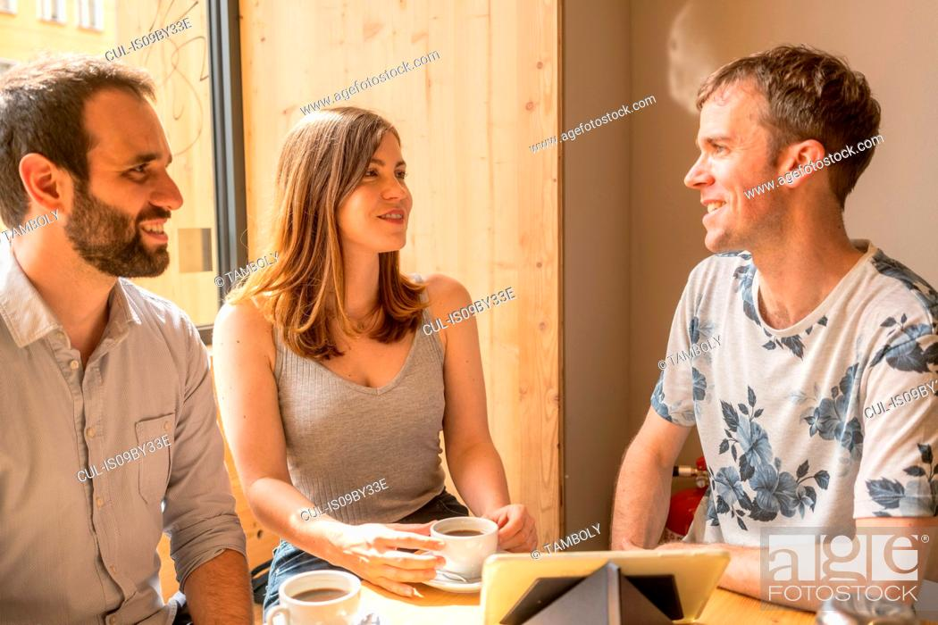 Stock Photo: Group of entrepreneurs meeting with coffee and digital tablet.
