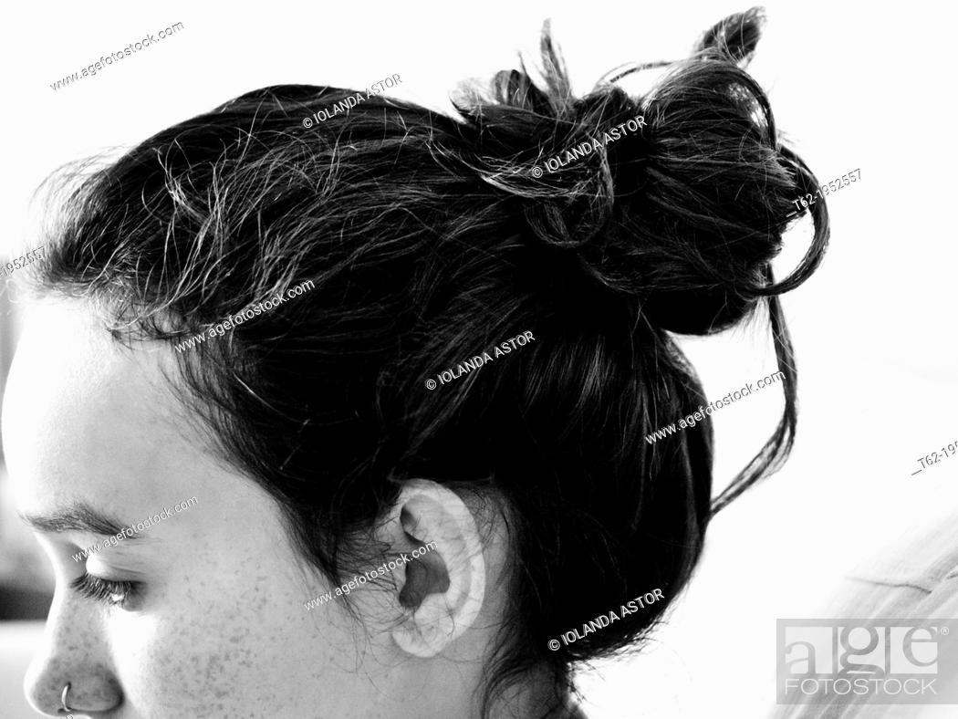 Stock Photo: Comfortable and modern hairstyle for a teenage girl. White and Black.