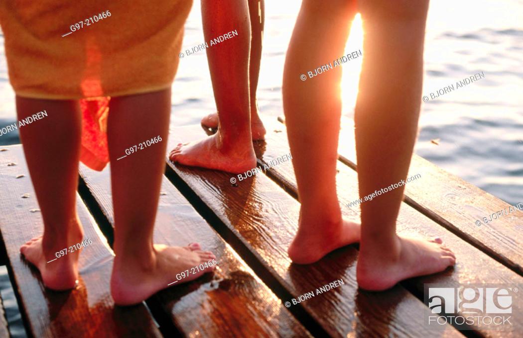 Stock Photo: Legs on jetty.