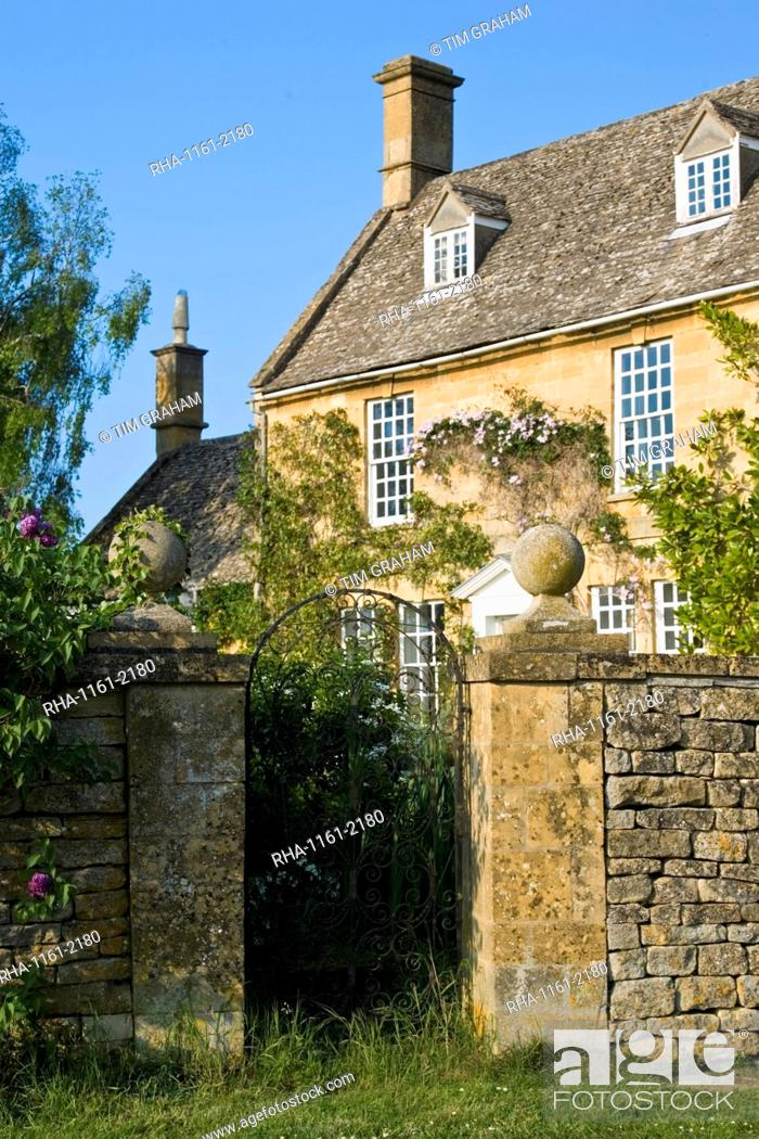 Stock Photo: Grand house period property with dry stone wall near Winchcombe, Gloucestershire, The Cotswolds, England, United Kingdom.