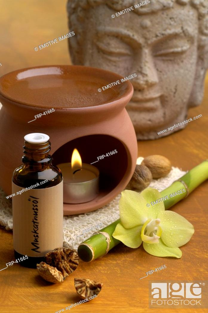 Stock Photo: Nutmeg oil aroma lamp.