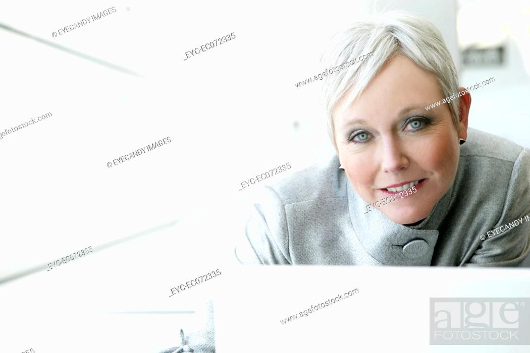 Stock Photo: Mature woman using laptop in airport.