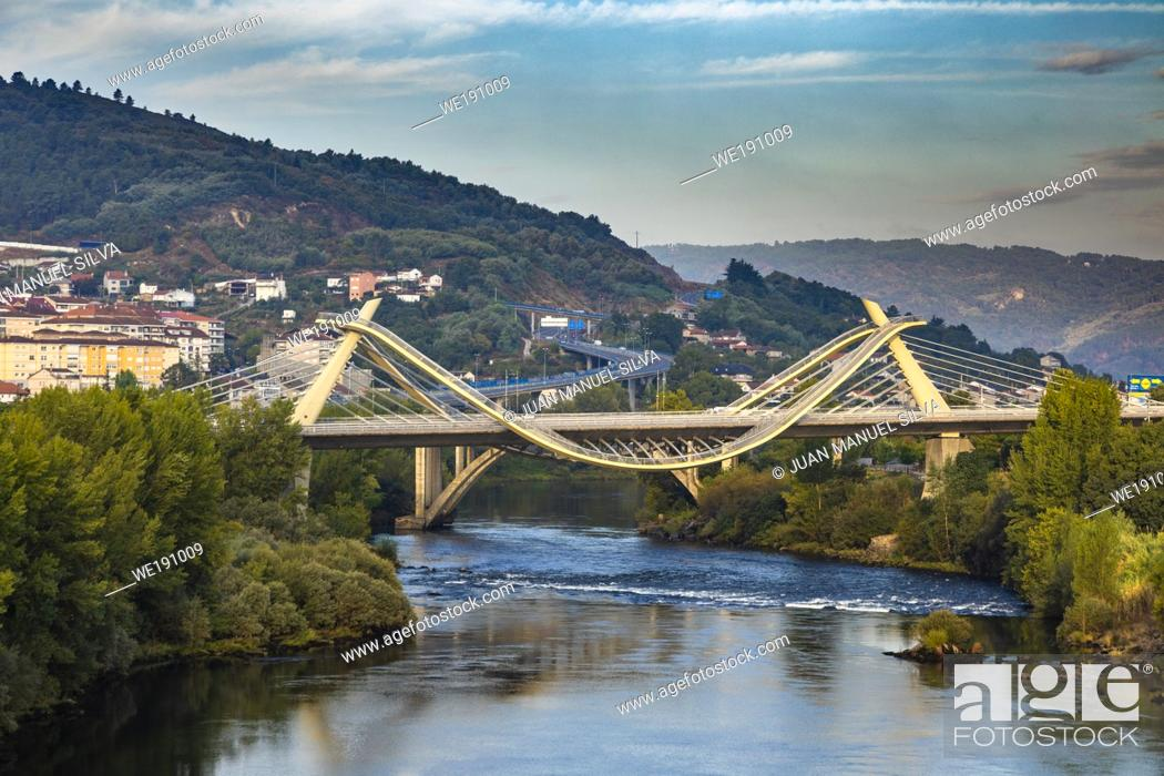 Stock Photo: Millennium Bridge over the Miño River with cityscape in background, Ourense, Galicia, Spain.