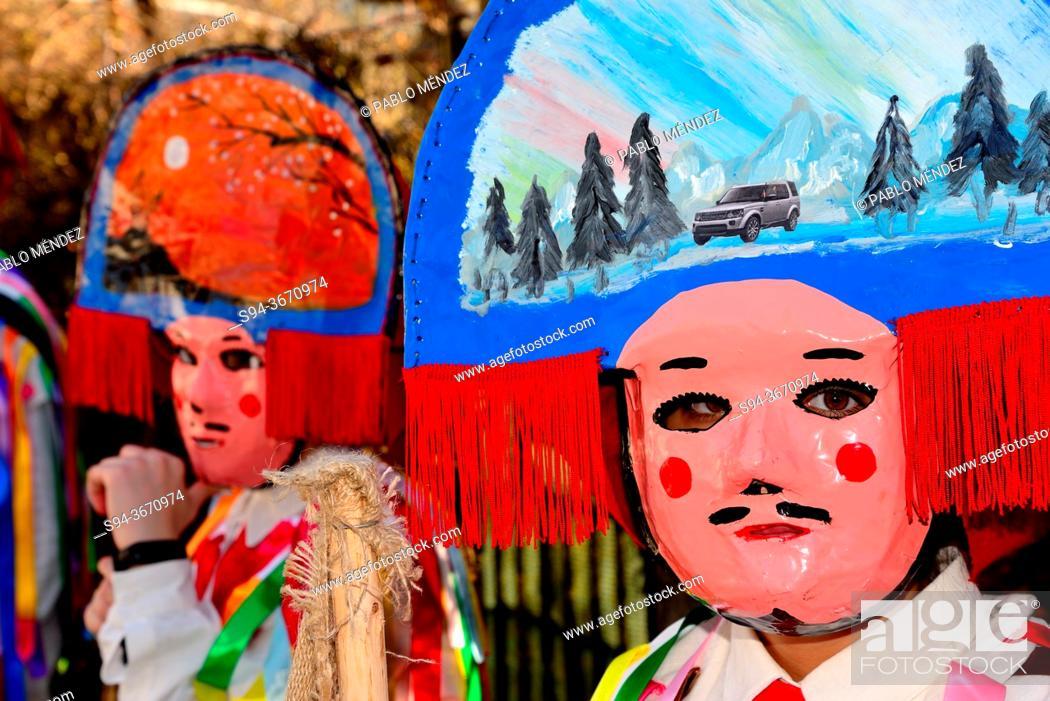Stock Photo: Chocalleiros. Traditional mask of the Entroido in Vilardevos, Orense, Spain.