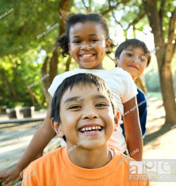 Stock Photo: Multi-ethnic children in park.