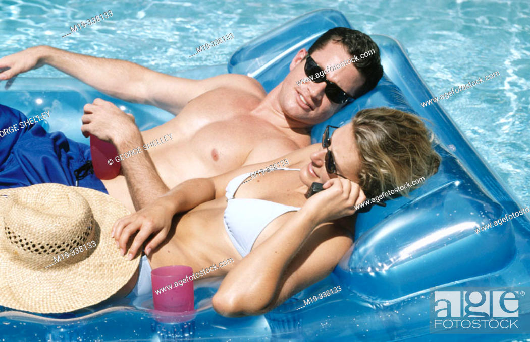 Stock Photo: couple sunning in a pool.