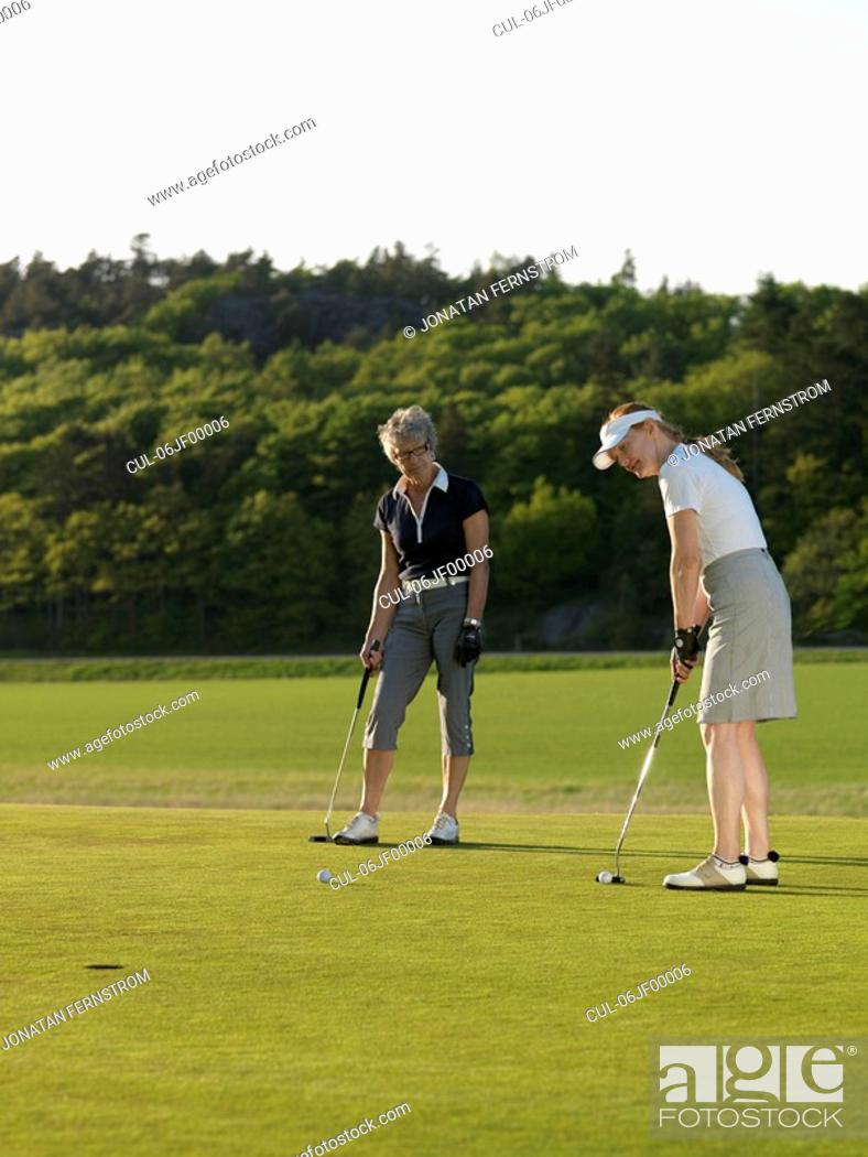 Stock Photo: Two women at golf green.