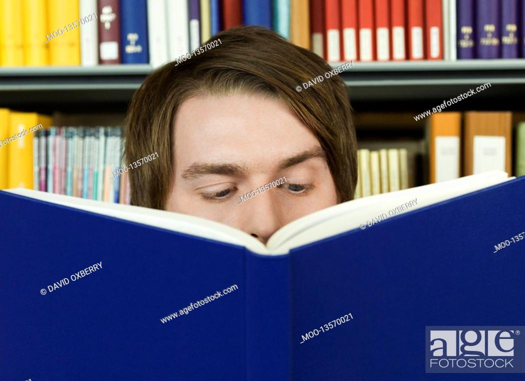 Stock Photo: Young man reading.