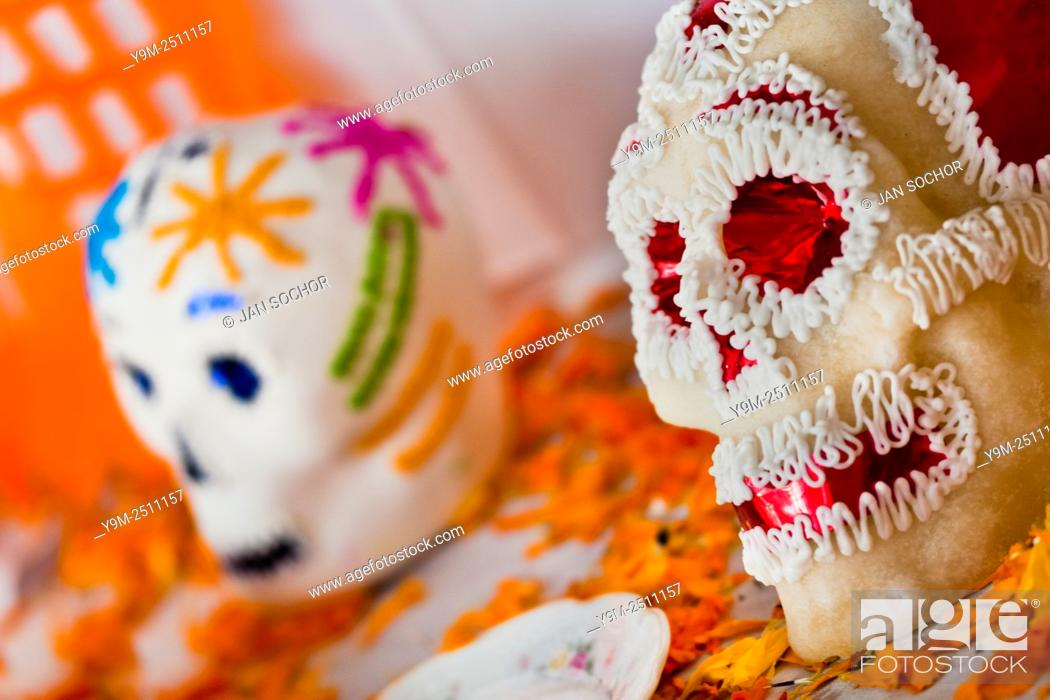 Stock Photo: Decorated sugar sculls are placed at the altar of the dead (altar de muertos), a religious site honoring the deceased, during the Day of the Dead celebration in.