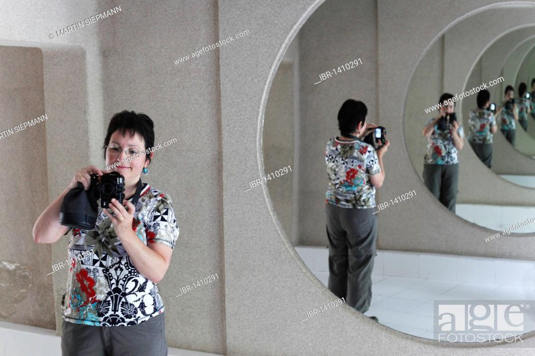 Stock Photo: Woman with a camera in a hall of mirrors, Jameos del Agua, designed by César Manrique, Lanzarote, Canary Islands, Spain, Europe.