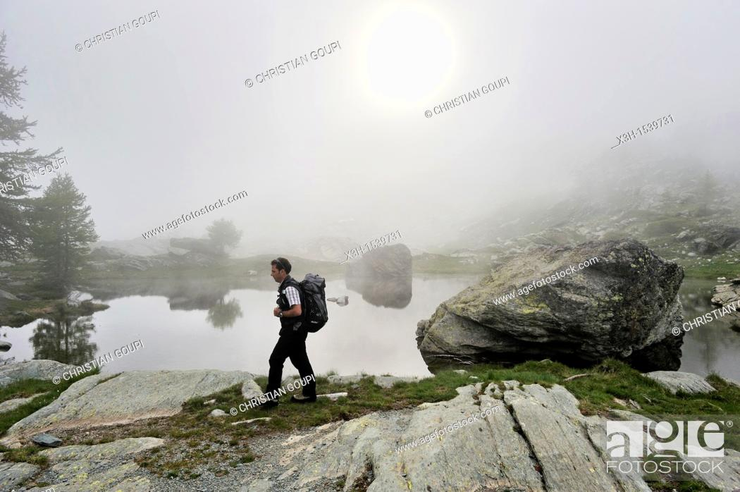 Stock Photo: fog over Twin Lakes in Fontanalba, Mercantour National Park Alpes-Maritimes department, Provence-Alpes-Cote d'Azur region, southeast of France, Europe.