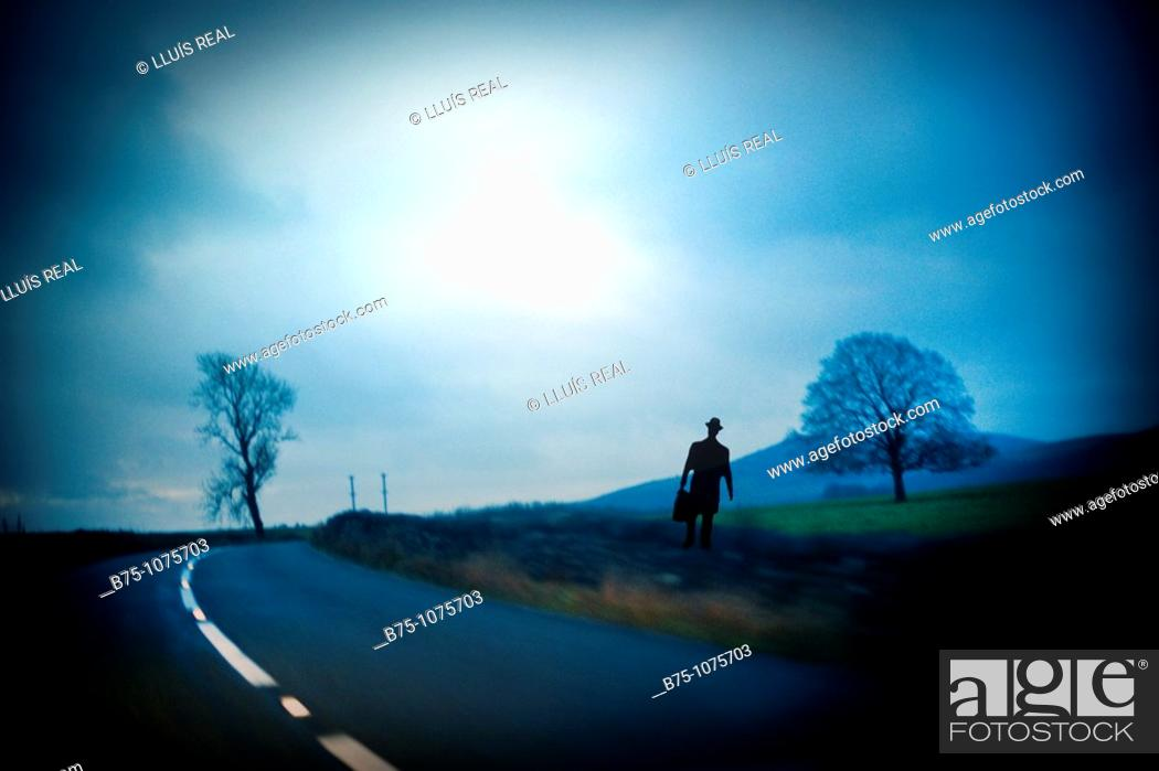 Stock Photo: Silhouette of man on a road.