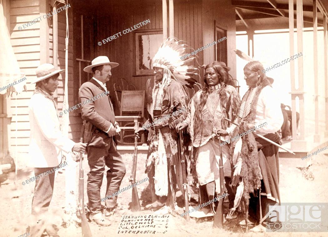 Stock Photo: The Interview. Three Cheyenne men, Standing Elk, No. 1; Running Hog, No. 2; Little Wolf, No. 3, wearing ceremonial clothing and holding rifles with Col.