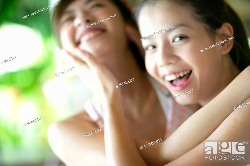Stock Photo: View of young women hugging.