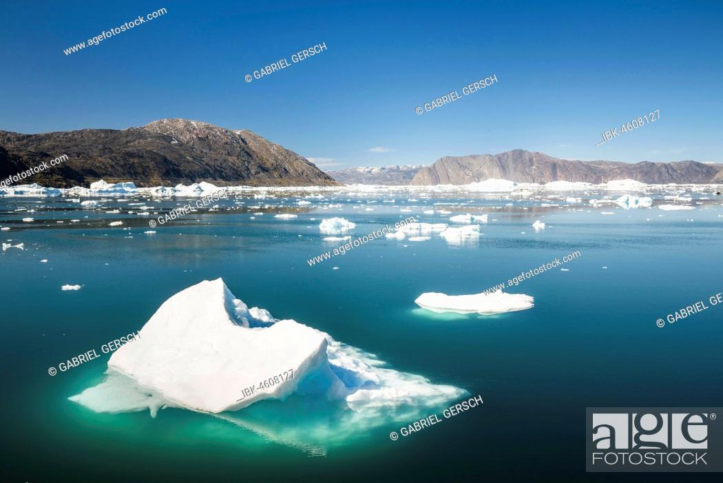 Stock Photo: Icebergs in the fjord, surrounded by mountains, West Greenland, Greenland.