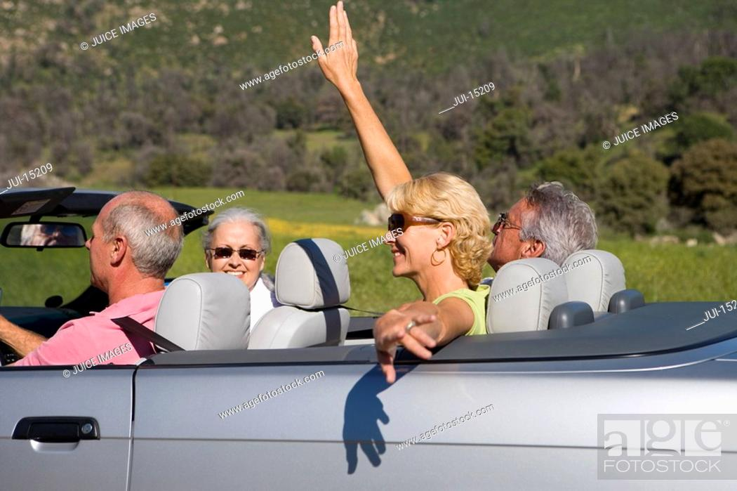 Stock Photo: Senior couple with friends in convertible car.
