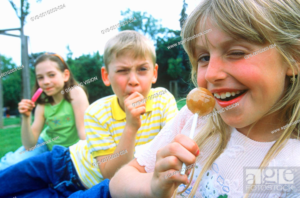 Stock Photo: Young children holding lollipops.
