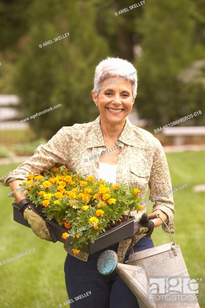 Stock Photo: Senior Hispanic woman gardening.