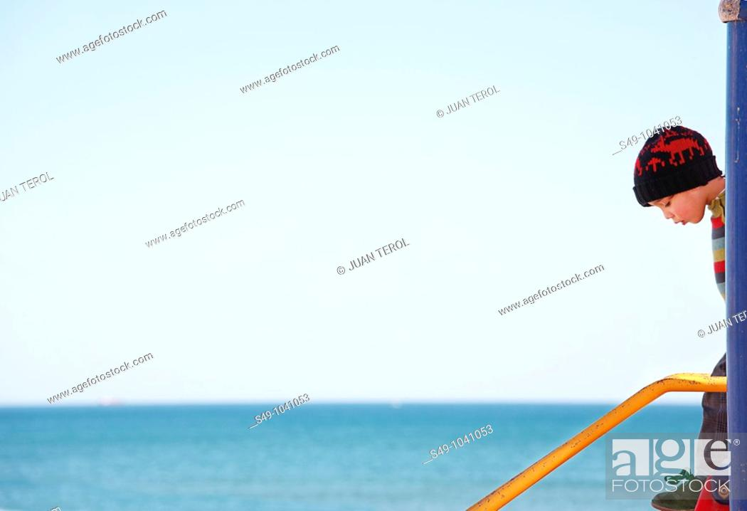 Stock Photo: kid playing on the beach.