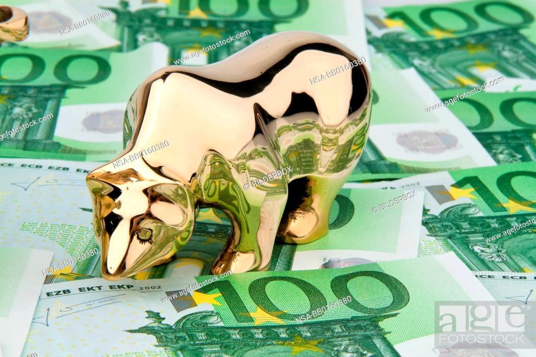 Stock Photo: Many euro banknotes. Bull and Bear.