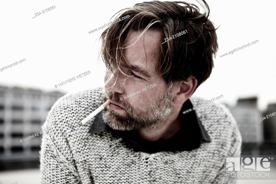 Imagen: Handsome Man Smoking Cigarette.
