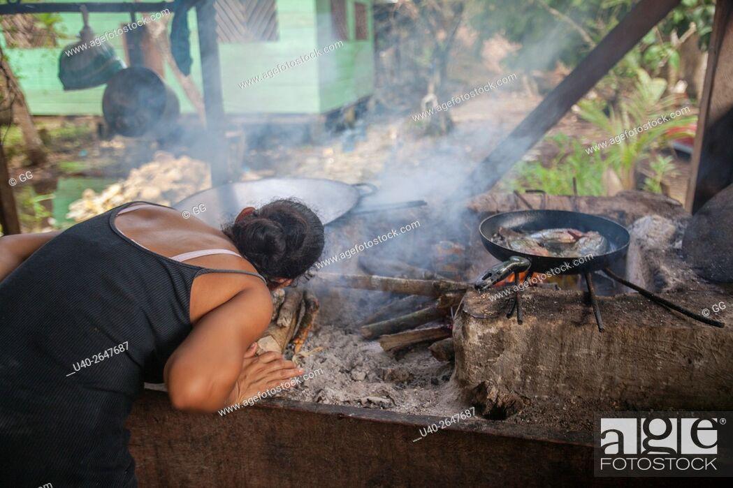 Stock Photo: Guatemala, Rio Dulce, open cooking fire.